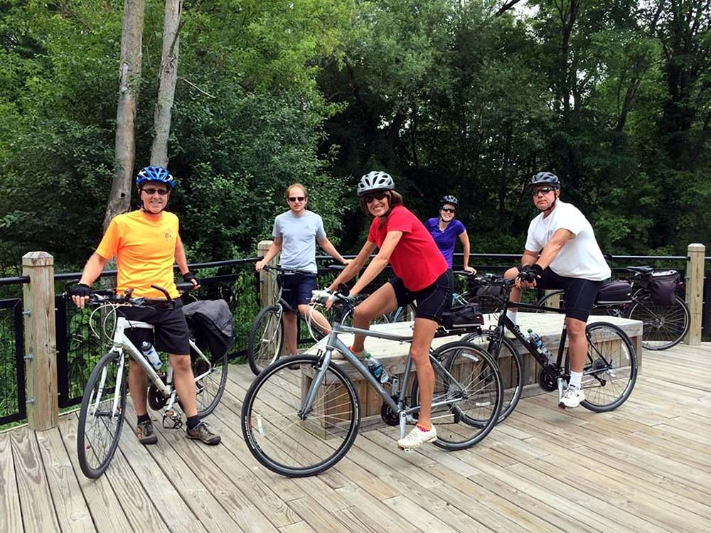 Huron Waterloo Pathways Initiative (HWPI) was inspired by the multi-use path from Dexter to Hudson Mills Metropark, the location of this photo. HWPI board members (front, from left) Jeff Hardcastle, Linda Mahan, and Rob Mahan enjoy a ride with family members Lucas and Emily Kizer (back).
