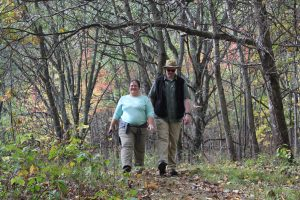 Two hikers walking on trail