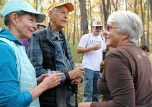 Two hikers chatting with former executive director Susan Lackey