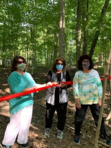 Shatter sisters cut ribbon at opening of Shatter Family Preserve